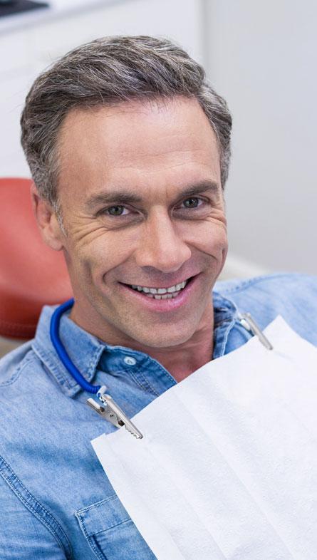 A Man sitting on dental chair